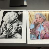 Two poster size prints on desk