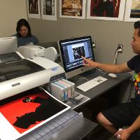 Student printing large color photo