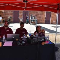 students sit at mt. sac broadcasting booth