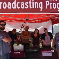 mt. sac broadcasting peogram students standing at booth