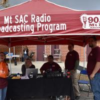 mt. sac broadcasting student crew sits at booth