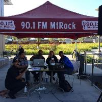 student talent sitting around mt. rock booth