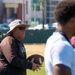 Coach holding ball