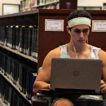 Student on laptop in Library