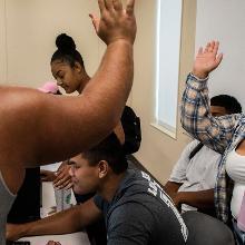 High fives between students