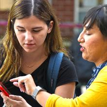 Student accessing smartphone and getting assistance
