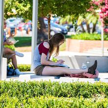 Student studying in shade