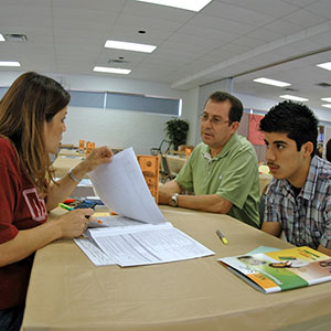 A student and parent receiving help from Financial Aid.
