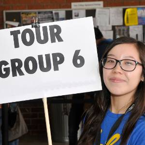 woman holding a sign for tour group 6