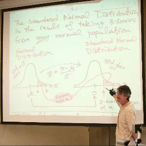 A professor discusses statistics in a lecture class.