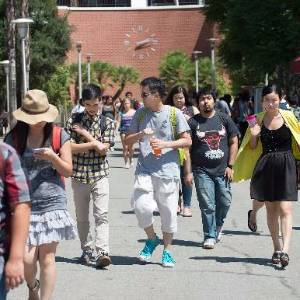 students walking in front of building 26