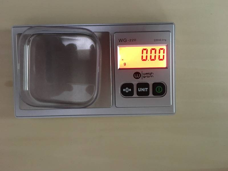 Picture showing balance with tared weigh boat and digital readout