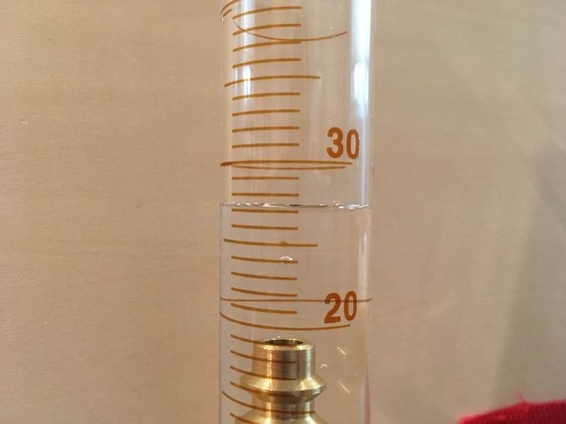 Volume reading on graduated cylinder with object for measurement