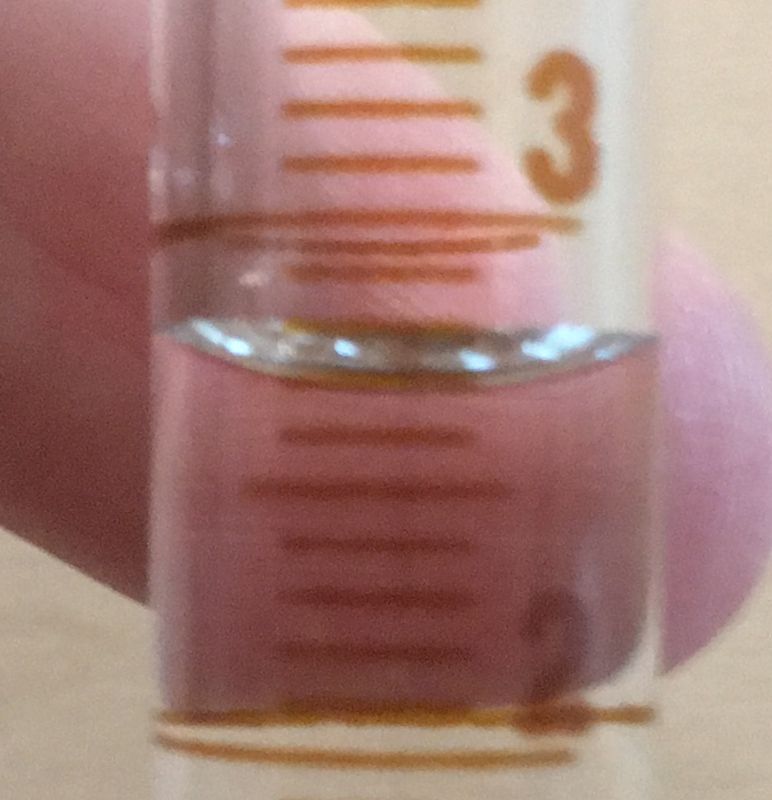 Close up of 10 mL graduated cylinder for reading
