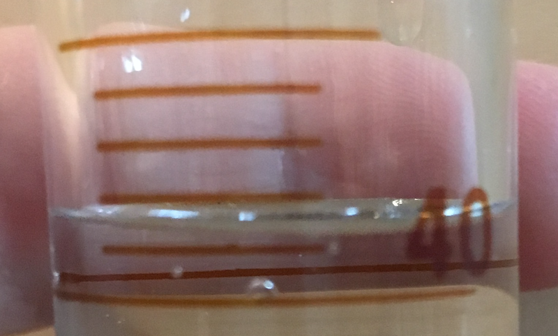 Close up of 50 mL graduated cylinder for reading