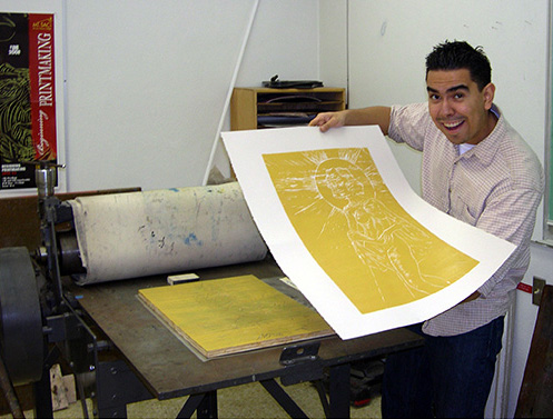 Student printing silk screened artwork