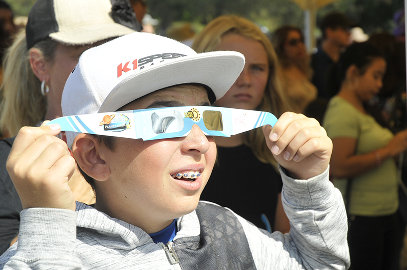 Kid looking at eclipse