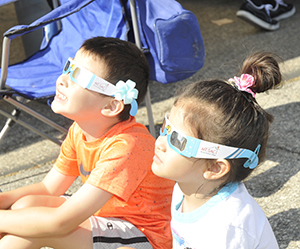 Kids looking at eclipse