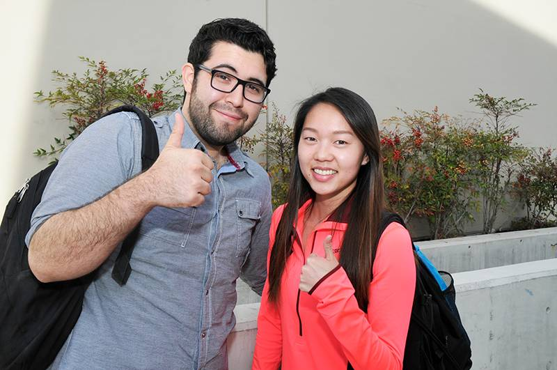 two students thumbs up