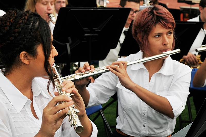 two girls playing flutes
