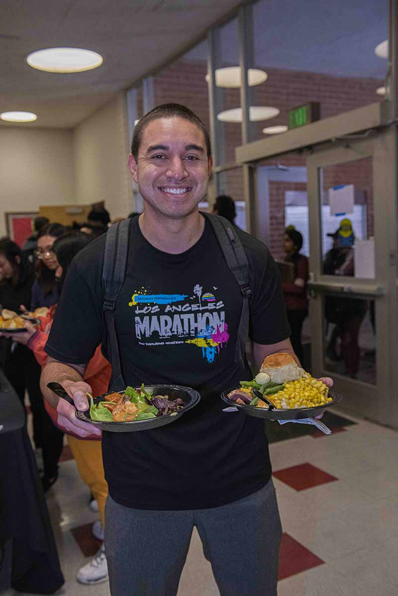 Student enjoys Thanksgiving Dinner