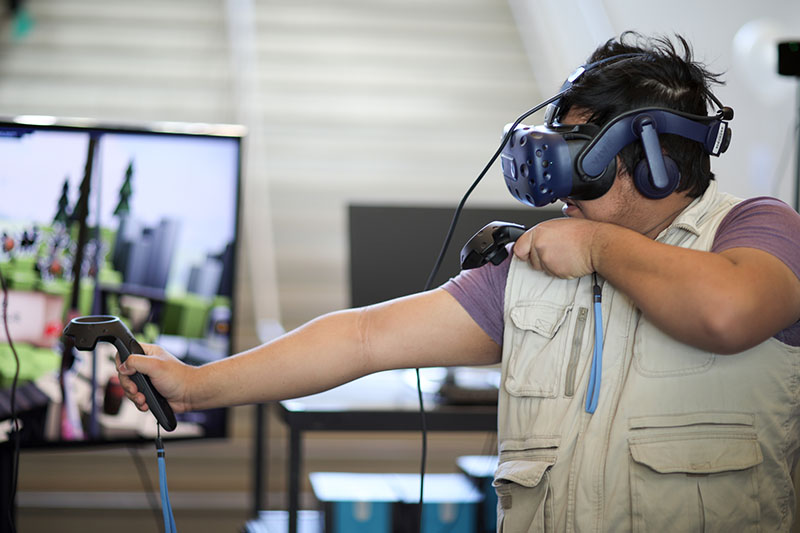 Student plays virtual reality game