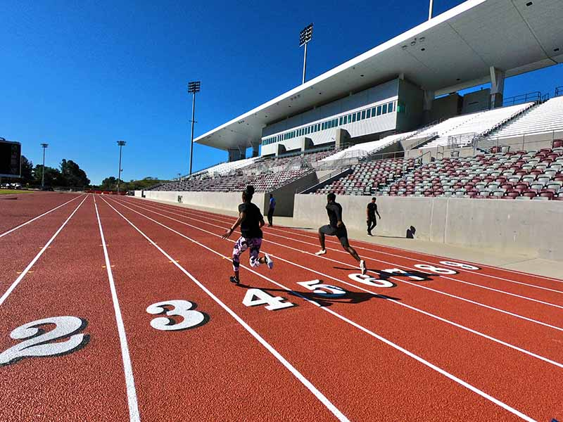 Runners practice at Hilmer Lodge stadium