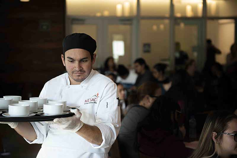 Students chefs serve the meal they made