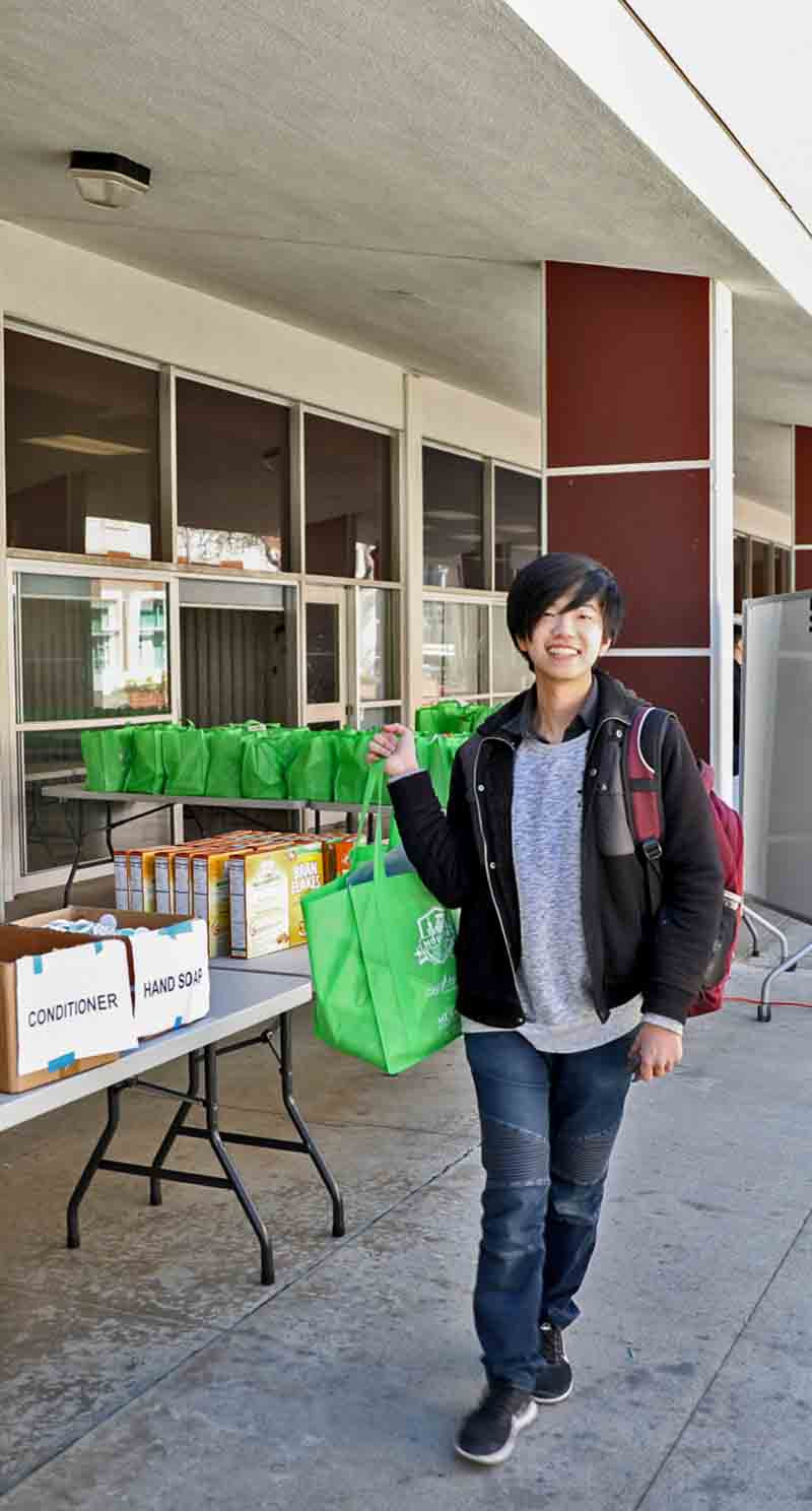 Student picks up groceries at the Pantry
