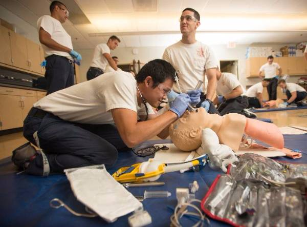 Paramedic student practicing intubation technique